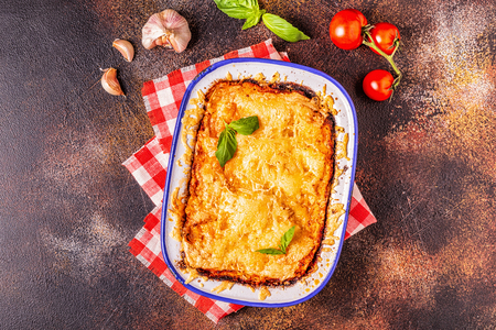 Traditional italian lasagna with vegetables, minced meat and cheese, top view, copy space. Stock Photo - 112413900