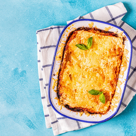 Traditional italian lasagna with vegetables, minced meat and cheese, top view, copy space. Stock Photo - 112413902