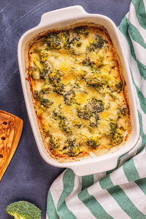 Broccoli gratin in a baking dish, top view.