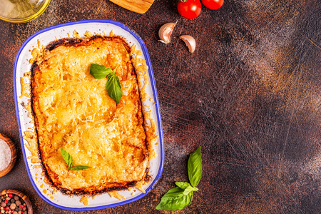 Traditional italian lasagna with vegetables, minced meat and cheese, top view, copy space. Stock Photo - 112414014