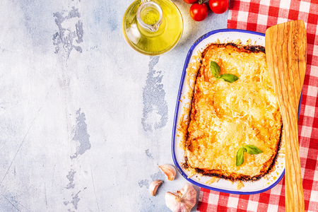 Traditional italian lasagna with vegetables, minced meat and cheese, top view, copy space. Stock Photo - 117179364