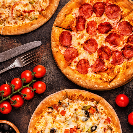 Set of different pizzas - pepperoni, vegetarian, chicken with vegetables, top view 写真素材