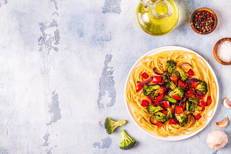 Pasta with broccoli, pepper, onion, top view. Reklamní fotografie