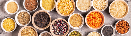 Set of different superfoods- whole grains, beans and legumes, seeds and nuts, top view. Foto de archivo - 116452573