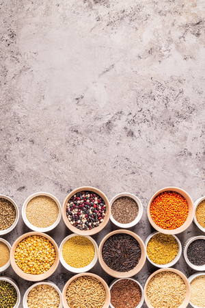 Set of different superfoods- whole grains, beans and legumes, seeds and nuts, top view. Foto de archivo - 116452601