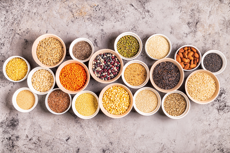 Set of different superfoods- whole grains, beans and legumes, seeds and nuts, top view. Stok Fotoğraf