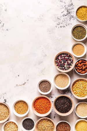 Set of different superfoods- whole grains, beans and legumes, seeds and nuts, top view. Stock Photo