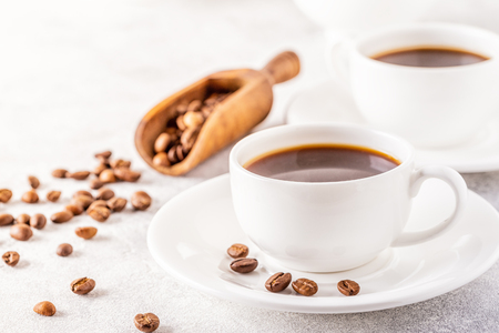 Concept of morning coffee, coffee break on a light background, selective focus, copy space. Archivio Fotografico