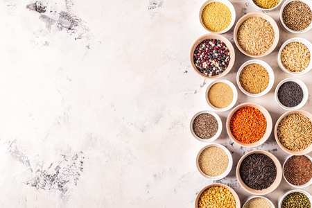 Set of different superfoods- whole grains, beans and legumes, seeds and nuts, top view. Foto de archivo - 116452637