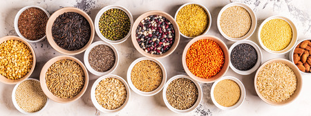 Set of different superfoods- whole grains, beans and legumes, seeds and nuts, top view. Foto de archivo - 116452659