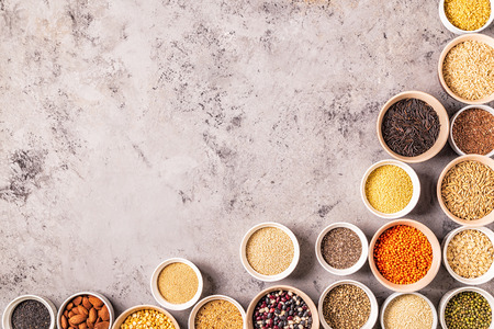 Set of different superfoods- whole grains, beans and legumes, seeds and nuts, top view. Foto de archivo - 116452666