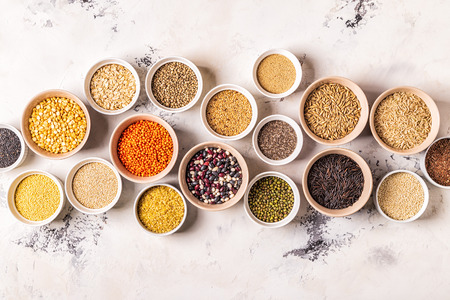 Set of different superfoods- whole grains, beans and legumes, seeds and nuts, top view. Фото со стока