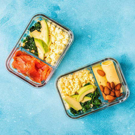 Healthy balanced lunch box, ketogenic diet lunch, home food for office concept. Фото со стока