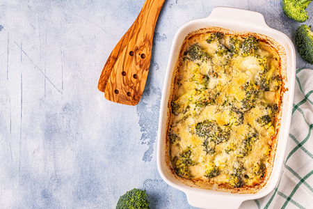 Broccoli gratin in a baking dish, top view. Stock Photo