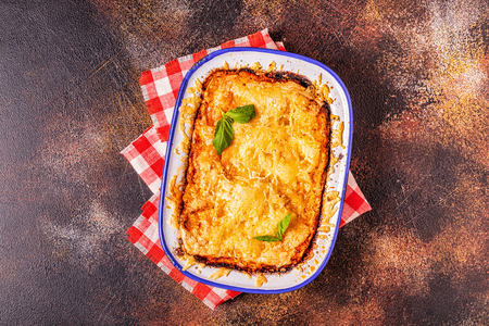 Traditional italian lasagna with vegetables, minced meat and cheese, top view, copy space. Stock Photo - 117813947