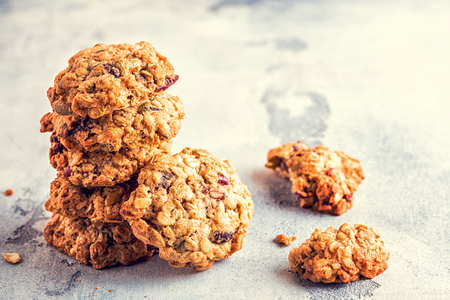 Homemade oatmeal cookies with cranberries, selective focus. Stock Photo