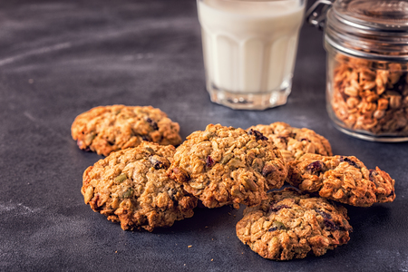 Homemade oatmeal cookies with cranberries, selective focus. Фото со стока