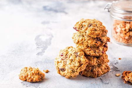 Homemade oatmeal cookies with cranberries, selective focus. Banco de Imagens