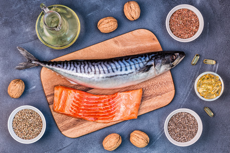 Sources of omega 3 - mackerel, salmon, flax seeds, hemp seeds, chia, walnuts, flaxseed oil. Healthy eating concept. Top view with copy space. Banque d'images
