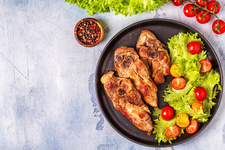 Roasted turkey steak with salad, top view. Stock Photo