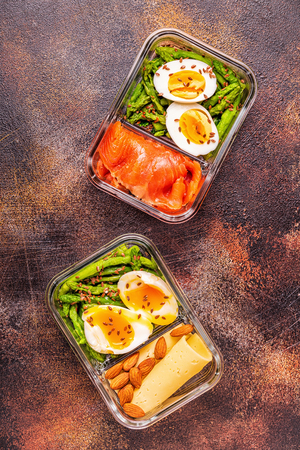 Healthy balanced lunch box, ketogenic diet lunch, home food for office concept. Stock Photo