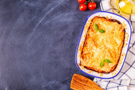 Traditional italian lasagna with vegetables, minced meat and cheese, top view, copy space.