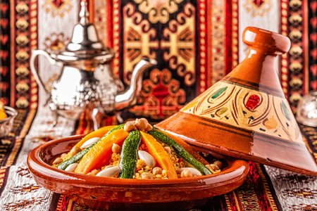Vegetable tagine with almond and chickpea couscous, selective focus.