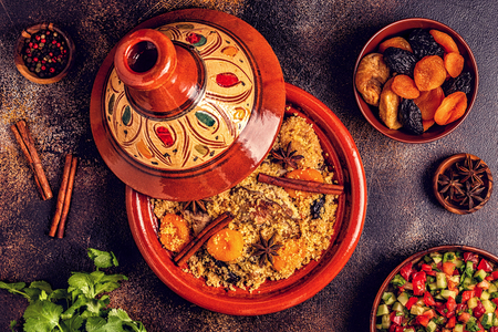 Traditional moroccan tajine of chicken with dried fruits and spices, top view. Stok Fotoğraf - 120959647