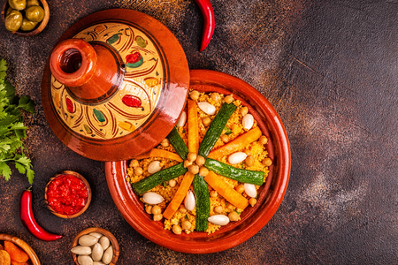 Vegetable tagine with almond and chickpea couscous, top view.