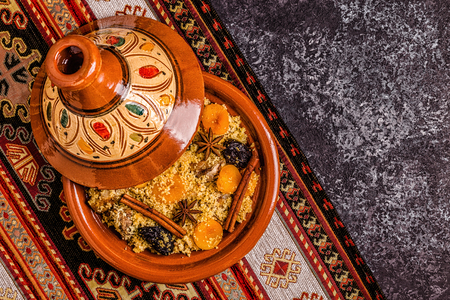 Traditional moroccan tajine of chicken with dried fruits and spices, top view.