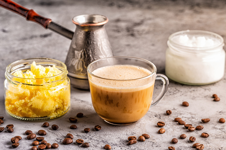 Coffee blended with ghee butter and MCT coconut oil, paleo, keto, ketogenic drink breakfast. Stock Photo