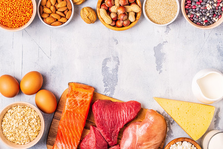 Sources of healthy protein - meat, fish, dairy products, nuts, legumes, and grains. 版權商用圖片
