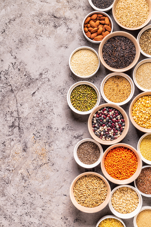 Set of different superfoods- whole grains, beans and legumes, seeds and nuts, top view. Foto de archivo - 122118092