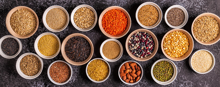 Set of different superfoods- whole grains, beans and legumes, seeds and nuts, top view. Imagens