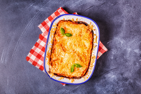 Traditional italian lasagna with vegetables, minced meat and cheese, top view, copy space. Stock Photo - 122120360