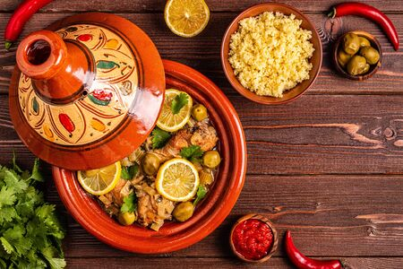 Traditional moroccan tajine of chicken with salted lemons, olives. Top view.