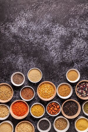 Set of different superfoods- whole grains, beans and legumes, seeds and nuts, top view. Foto de archivo - 126949863