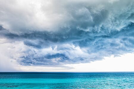 Storm clouds over the sea. 스톡 콘텐츠