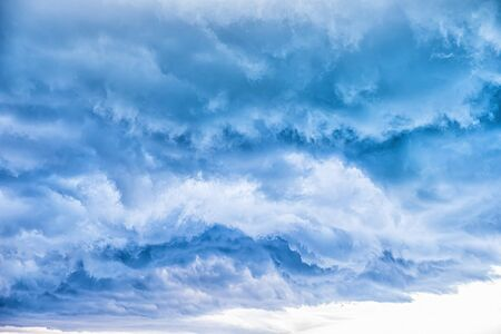 White clouds in blue sky, abstract blurred background.