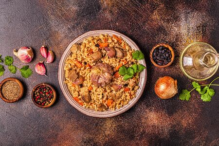 Pilaf with meat, vegetables and spices, top view.