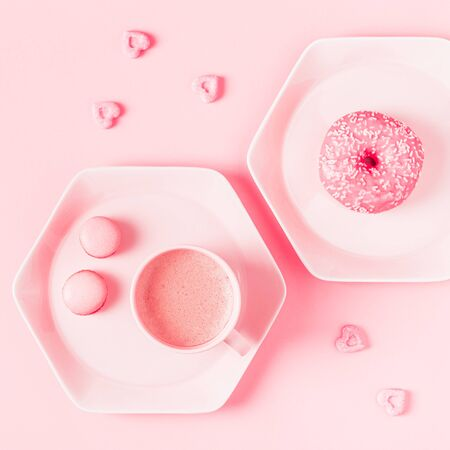 Breakfast with coffee on a pastel pink background. Flat lay, top view.