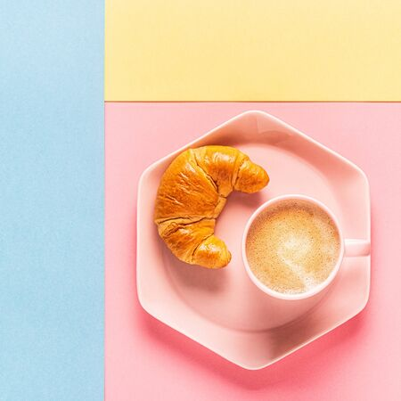 Coffee and croissants on a bright trendy background, top view, flat lay.
