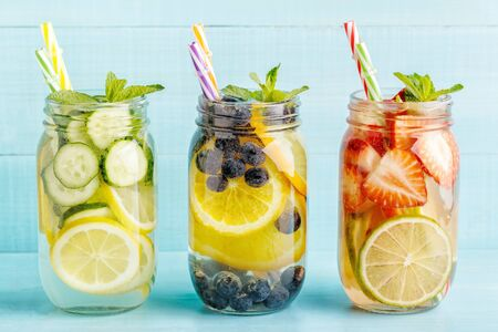 Detox fruit infused water. Refreshing summer homemade cocktail, selective focus.