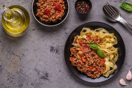 Tasty classic italian pasta bolognese, top view.