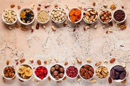 Nuts and dried fruits assortment, top view. Banco de Imagens