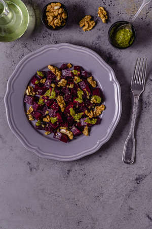 Beetroot, pesto sauce and walnut salad, top view Stock Photo