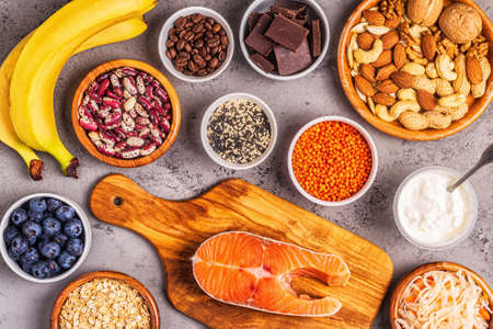 Healthy foods that lift your mood - salmon, dark chocolate, fermented foods (sauerkraut, yogurt), bananas, berries, nuts, oats, beans, lentils and coffee.