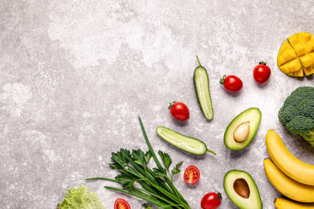 Healthy vegetables and fruits background with copy space. Imagens