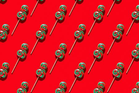 Lollipop sweet caramel candy pattern, top view. Reklamní fotografie