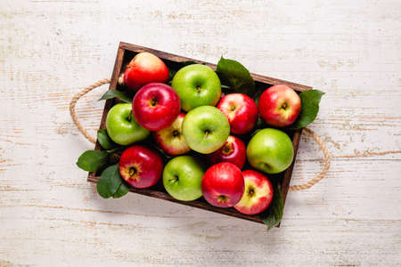 Ripe red and green apples in wooden box. Top view with copy space. Reklamní fotografie